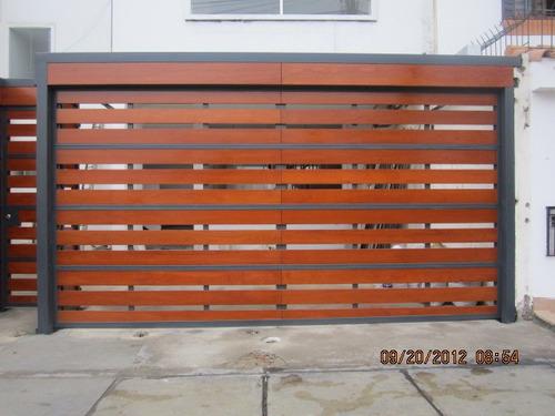 Puertas garaje madera puerta de garaje de madera de iroko - Puertas de garaje de madera ...